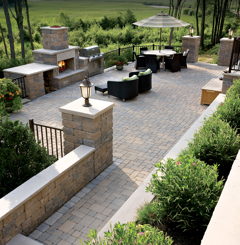High Quality Paver Patio, Block Pillars And Fireplace With Limestone Caps.