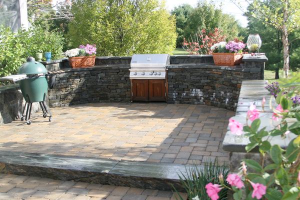 A Tumbled Bluestone Wall Houses A Built In Grill For A Patio At A Home In  Hamilton, Mass.